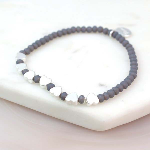 Grey bead bracelet with matt silver plated hearts | Image 1