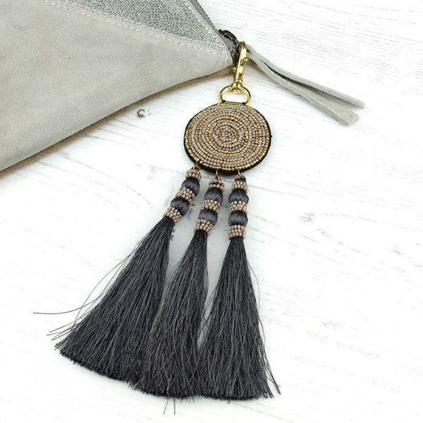 Taupe and grey beaded bag charm with tassels | Image 1