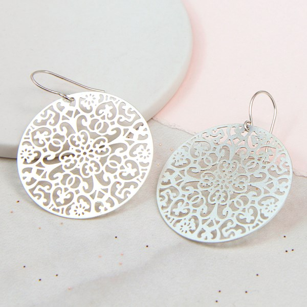 Silver plated circle earrings with laser cut filigree design | Image 1