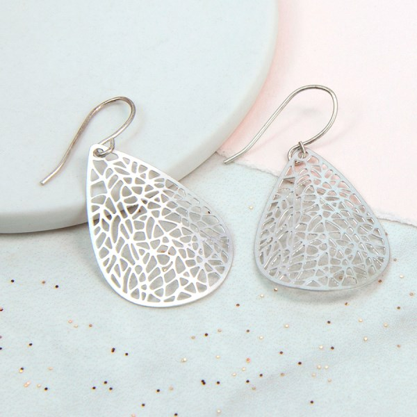 Silver plated teadrop earrings with laser cut filigree | Image 1