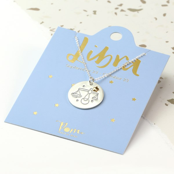 Silver plated Libra zodiac necklace with a golden star | Image 1