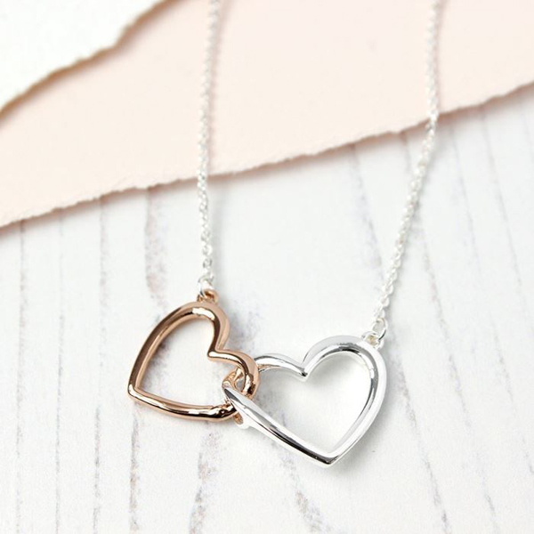 Silver and rose gold plated linked hearts necklace | Image 1