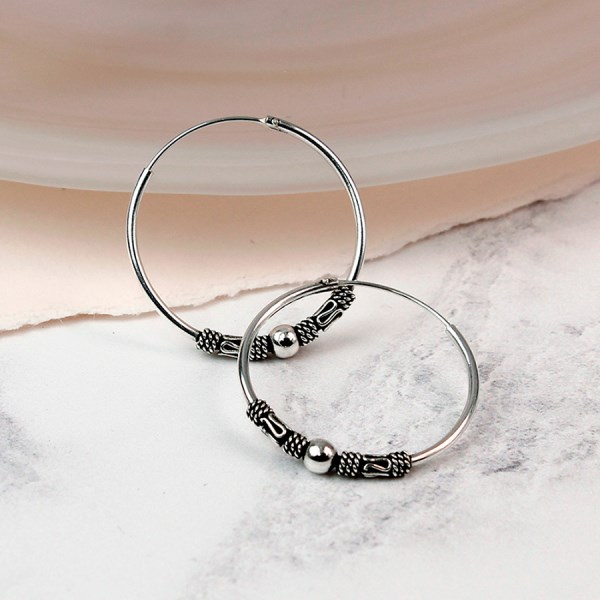 Sterling silver medium decorative hoop earrings | Image 1