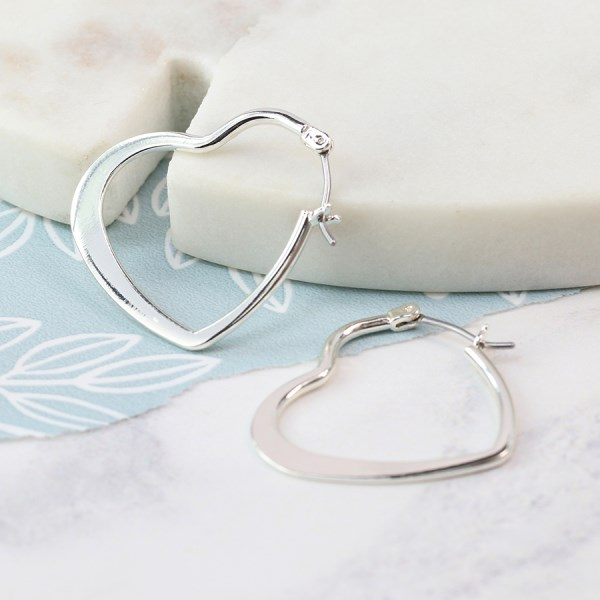 Silver plated heart shaped hoop earrings | Image 1