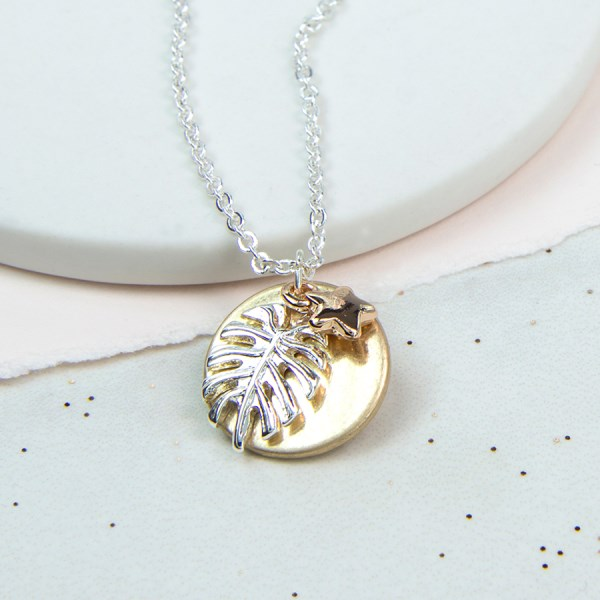 Golden disc, silver palm leaf and rose gold star necklace | Image 1