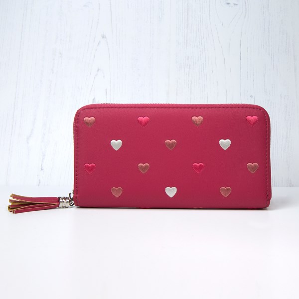 Pink faux leather purse with embroidered hearts and tassel | Image 1