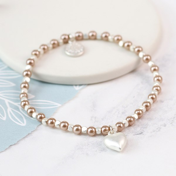Pink faux pearl and silver plated matt heart bracelet | Image 1