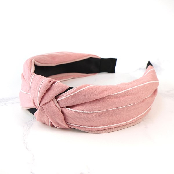 Pink fabric headband with fine white stripes | Image 1