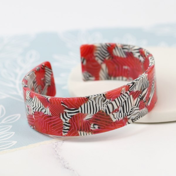 Red acrylic bangle with striking zebra pattern | Image 1