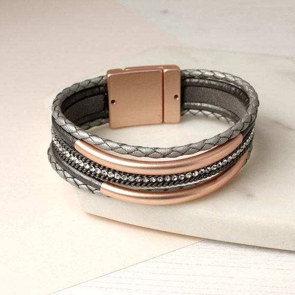 Metallic grey bracelet with rose gold curves and crystals | Image 1