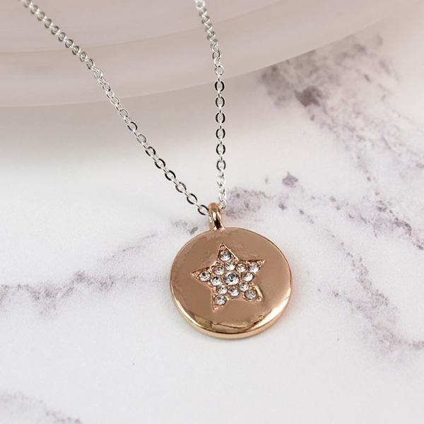 Rose gold plated disc necklace with a crystal star | Image 1