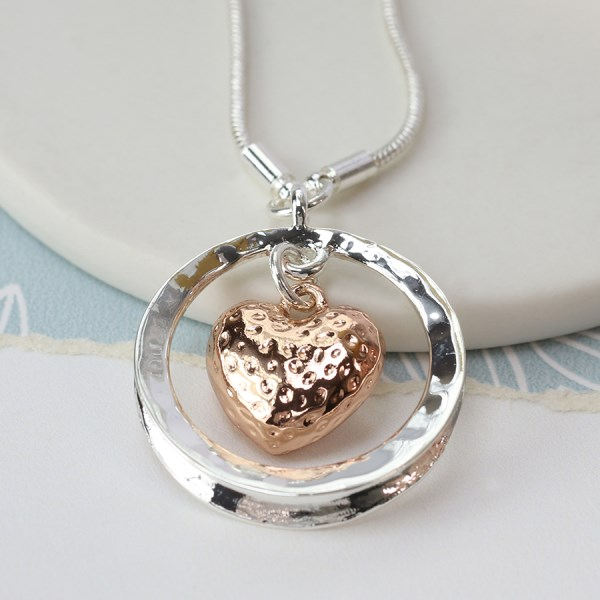 Rose gold hammered heart and silver circle necklace | Image 1