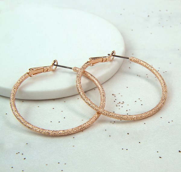 Rose gold large hoop earrings with sparkle texture | Image 1