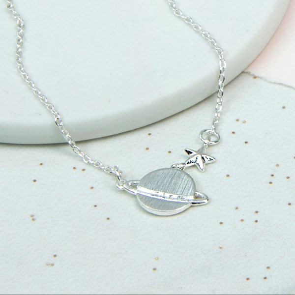 Silver plated fine chain necklace with Saturn and star | Image 1