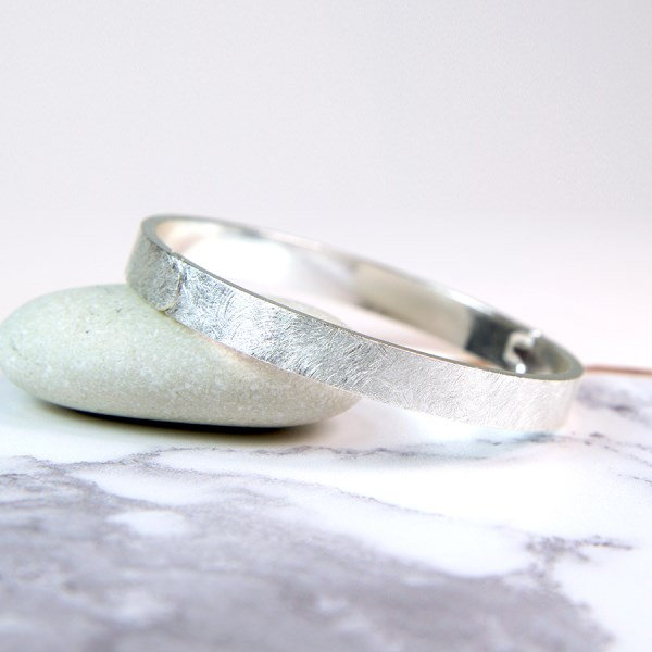 Silver plated wide bangle with a scratched finish | Image 1