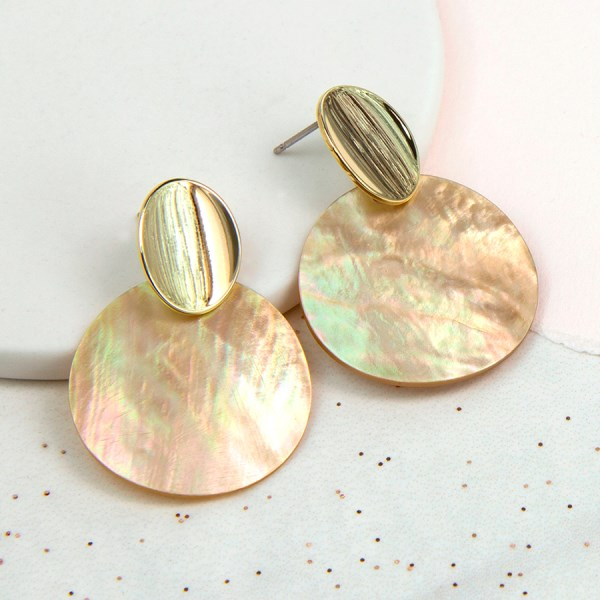 Golden curved oval stud earrings with large shell disc | Image 1