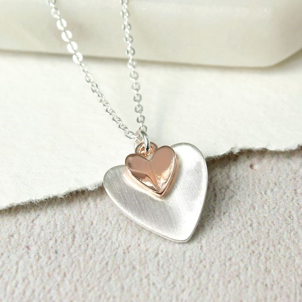 Brushed silver and rose gold plated folded hearts necklace | Image 1