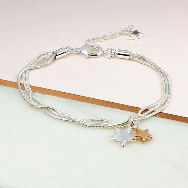 Triple strand silver plated chain bracelet with stars | Image 1