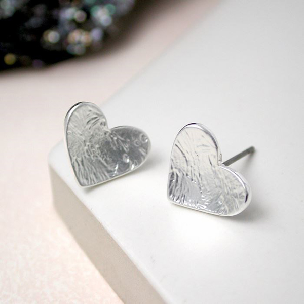 Textured silver plated heart stud earrings | Image 1
