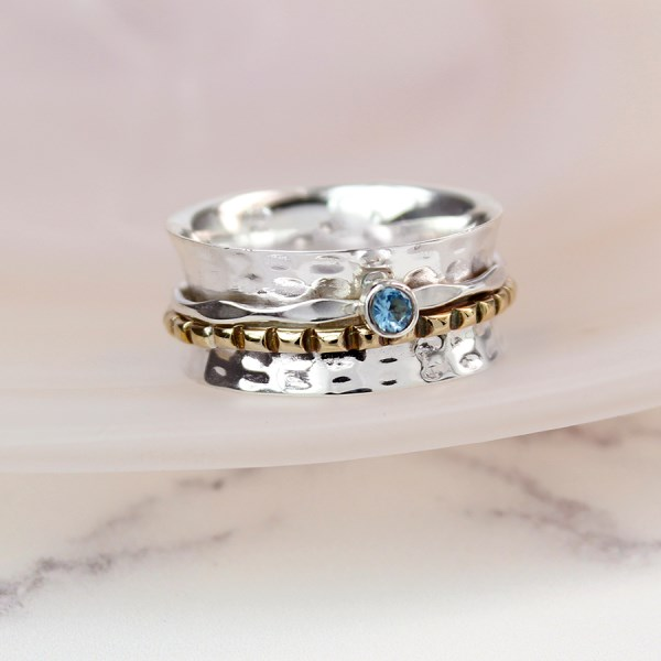Sterling silver spinning ring with Blue Topaz gemstone | Image 1