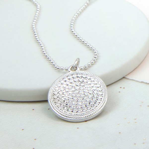 Silver plated studded disc necklace in a worn finish | Image 1