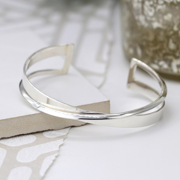Sterling silver bangle with crossover design and square edges | Image 1