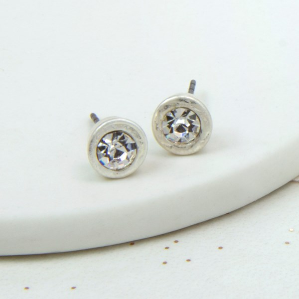 Silver plated crystal stud earrings with a worn finish | Image 1