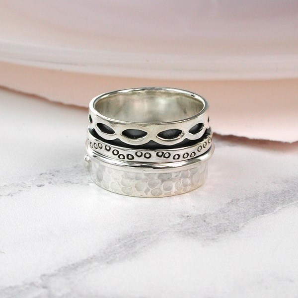 All silver spinning ring with decorative moving bands | Image 1