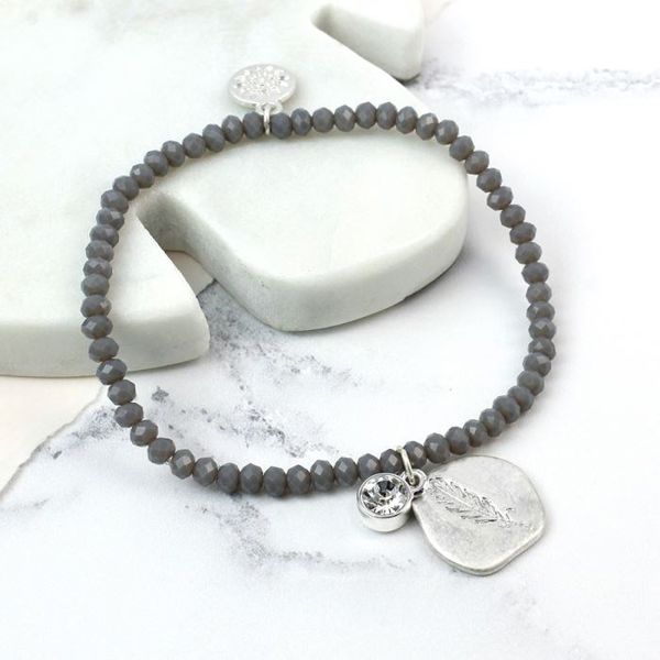 Grey bead and silver plated feather imprint bracelet | Image 1