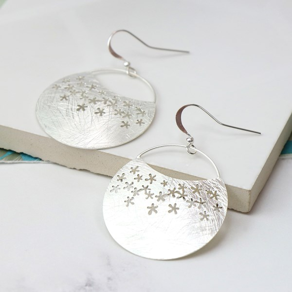 Silver plated scratched crescent and flower detail earrings | Image 1