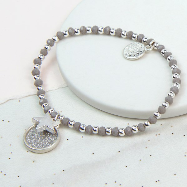 Silver plated sparkle disc and star bracelet with grey beads | Image 1