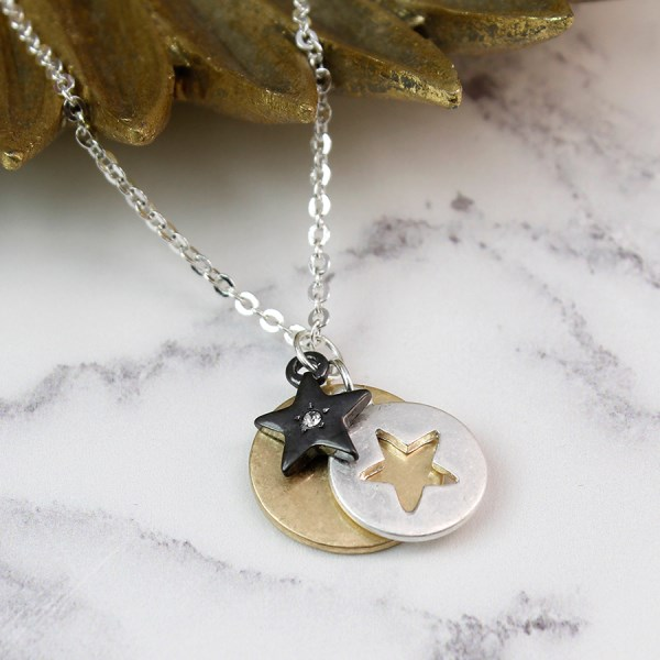 Silver and gold plated disc necklace with hematite star | Image 1