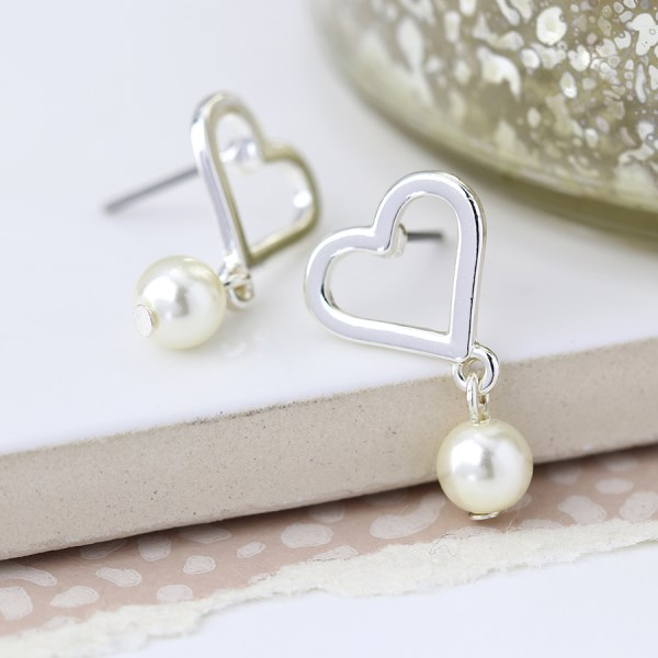 Silver plated heart and ivory pearl stud earrings | Image 1