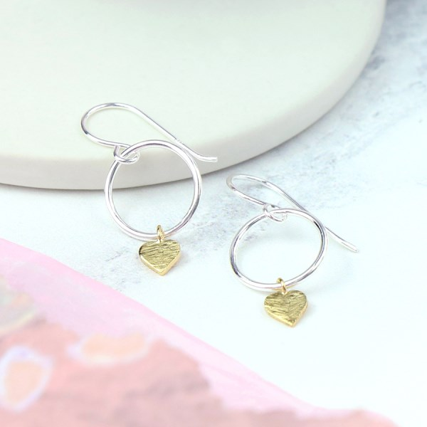 Sterling silver earrings with hoops and gold hearts | Image 1
