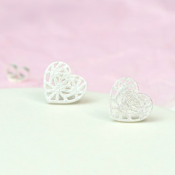 Sterling silver heart stud earrings with decorative latticework | Image 1