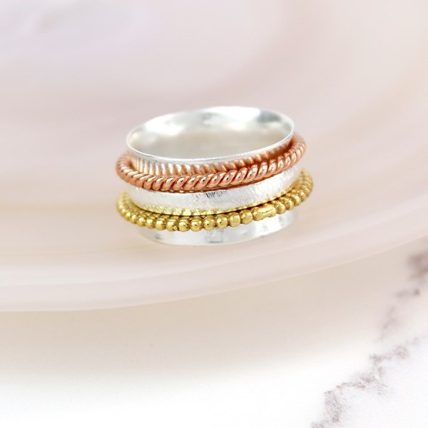 Sterling silver spinning ring with mixed metal twists | Image 1
