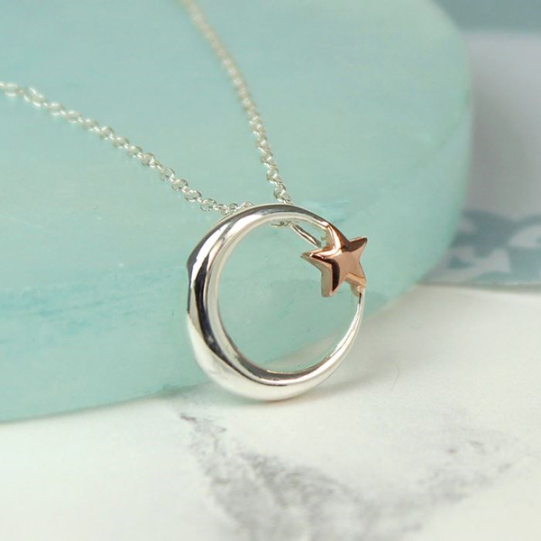 Sterling silver and rose gold moon and star necklace | Image 1