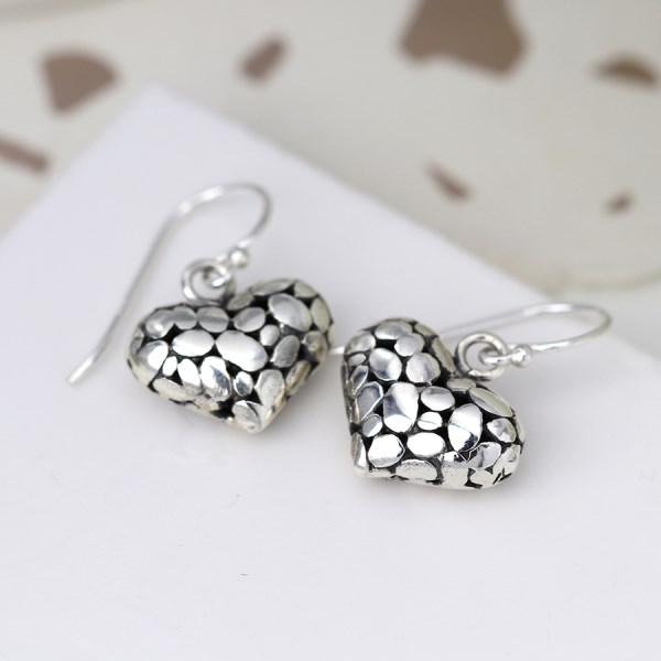 Sterling silver heart drop earrings with pebble finish | Image 1
