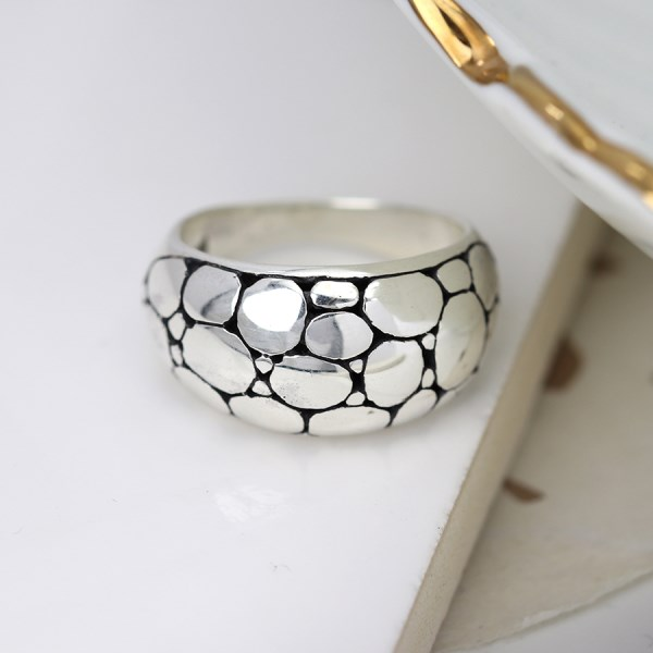 Sterling silver ring with smooth multi pebble finish | Image 1