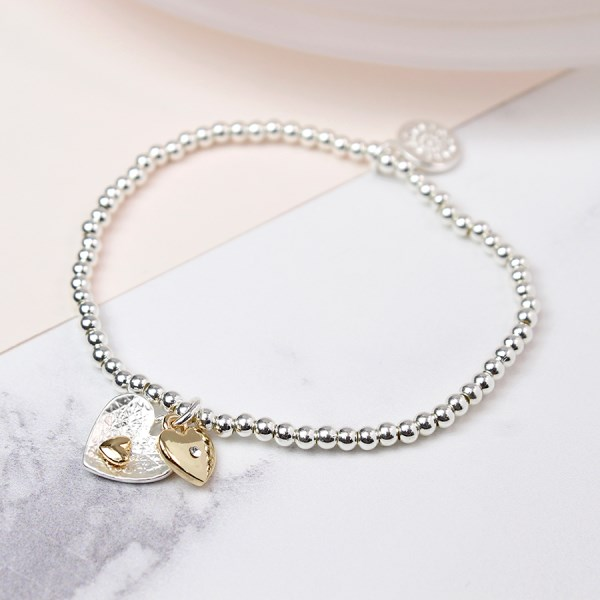 Silver and gold plated double heart charm bracelet | Image 1