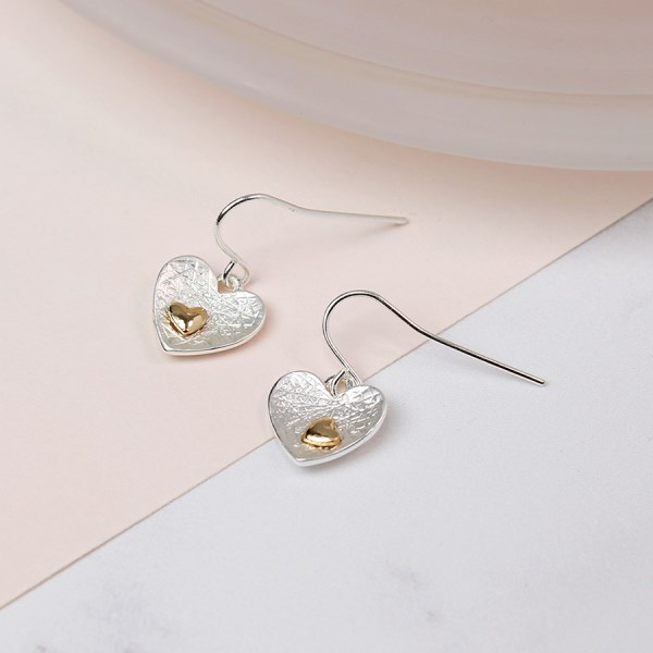 Silver plated heart and gold plated heart inset earrings | Image 1