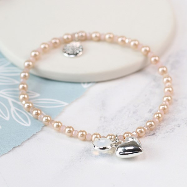 Pearl, smoky crystal and silver plated heart bracelet | Image 1