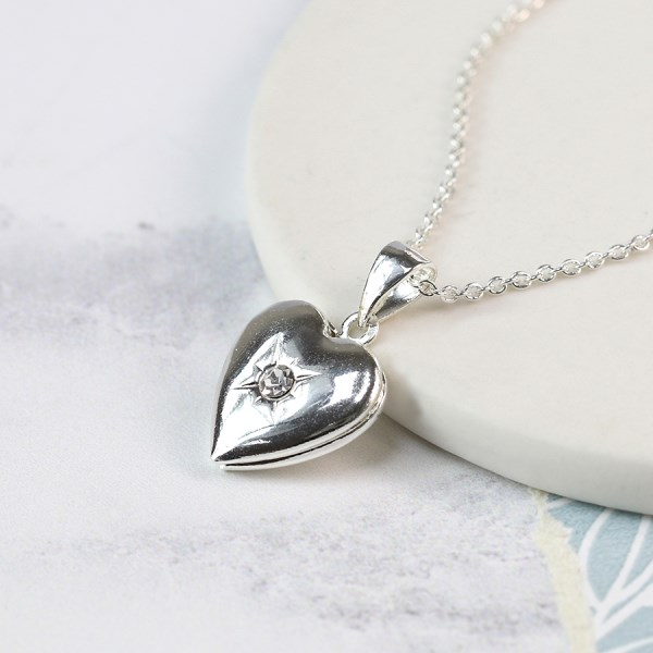 Silver plated heart locket with a faceted crystal centre | Image 1