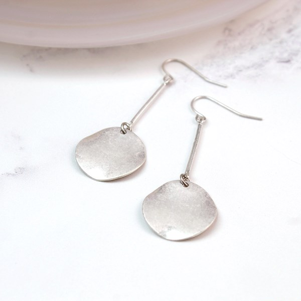 Silver plated pendulum earrings in a worn finish | Image 1
