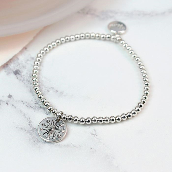 Silver plated bead bracelet with a crystal starburst charm | Image 1