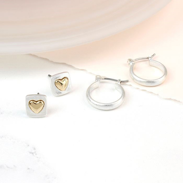 Silver and gold heart studs and silver hoop earring set | Image 1