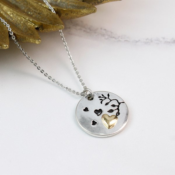 Silver plated tree disc necklace with gold plated heart | Image 1
