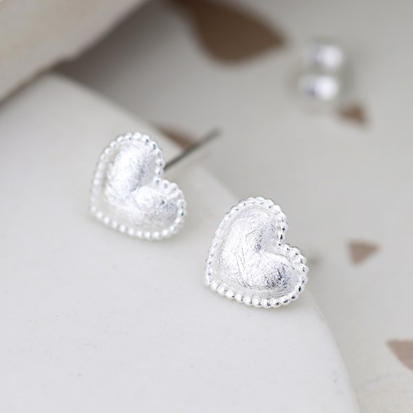 Sterling silver heart stud earrings with a scratched finish | Image 1