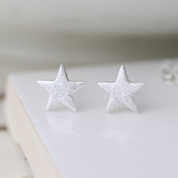 Sterling silver star stud earrings with a scratched finish | Image 1