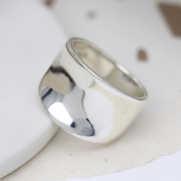 Sterling silver ring with a smooth concave band | Image 1